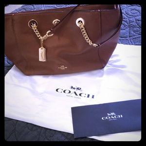 Coach handbag with gold hardware